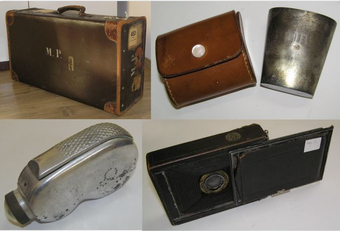 "Personal possessions of Mihailo Petrović, his faithful friends on the road: a leather suitcase with initials; his metal cup in a leather casing, with his initials; the mechanically powered dynamo flashlight (""Luzy""); a photo camera (Hutig A:G Dresden, 1908). I. Marković, 2018 (""Mihailo Petrović"" Foundation)"